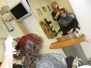 applying red colour to hair stage 2